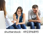 sad couple listening to a... | Shutterstock . vector #492396895