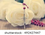 catholic rosary and white roses ... | Shutterstock . vector #492427447