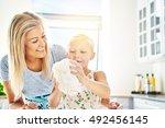 proud little girl kneading the... | Shutterstock . vector #492456145