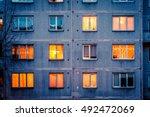 wall with iluminated windows.... | Shutterstock . vector #492472069