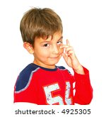 Boy making a funny face (isolated) - Who? Me? - stock photo