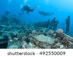 divers and marine shipwreck | Shutterstock . vector #492550009