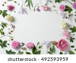 Stock photo border of pink and white roses with green leaves 492593959