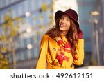 woman in autumn city | Shutterstock . vector #492612151