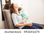portrait of an exhausted mother ... | Shutterstock . vector #492641674