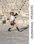 Pretty dancer in ancient amphitheatre Kourion in Cyprus. - stock photo