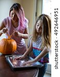 mother and daughter carving a... | Shutterstock . vector #492646951