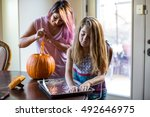 mother and daughter carving a... | Shutterstock . vector #492646975