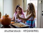 mother and daughter preparing... | Shutterstock . vector #492646981