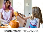 mother and daughter carving a... | Shutterstock . vector #492647011
