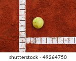 Red ash tennis court with lines and ball - stock photo