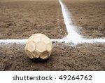 Soccer ball on a ash football court - stock photo
