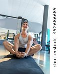 Small photo of Male fitness model doing sit ups and crunches exercising abdominal muscles