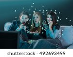 teenage girls watching horror... | Shutterstock . vector #492693499