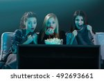 teenage girls watching horror... | Shutterstock . vector #492693661
