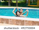cute asian child playing in... | Shutterstock . vector #492753004