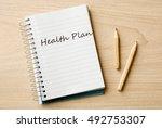 health plan on notebook on desk | Shutterstock . vector #492753307