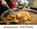 chef cooking pasta with tomato... | Shutterstock . vector #492755401