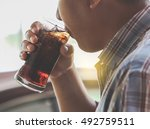 man drinking a glass of soda... | Shutterstock . vector #492759511