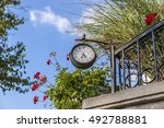 Street Clock On The Fence In...