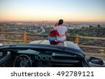 couple watching sunset from... | Shutterstock . vector #492789121