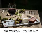 glass of red wine with grapes... | Shutterstock . vector #492855169