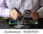 chip soldering man hands | Shutterstock . vector #492859054