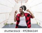 young black woman listening... | Shutterstock . vector #492866164