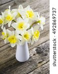 white daffodils at china vase... | Shutterstock . vector #492869737