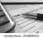 us tax form 1040 with pen and... | Shutterstock . vector #492888925
