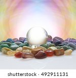crystal ball surrounded by... | Shutterstock . vector #492911131