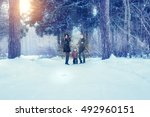 mom dad and son in the winter...   Shutterstock . vector #492960151