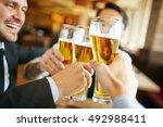 businessmen drinking beer after ... | Shutterstock . vector #492988411