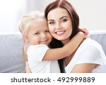happy mother with daughter on... | Shutterstock . vector #492999889