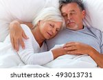 senior couple sleeping in bed  | Shutterstock . vector #493013731