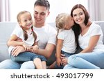 happy parents with daughters on ... | Shutterstock . vector #493017799