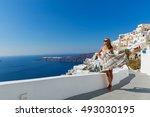 young beautiful woman walking... | Shutterstock . vector #493030195