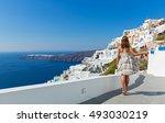 young beautiful woman walking... | Shutterstock . vector #493030219