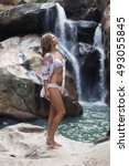 Woman On A Waterfall In A Whit...