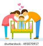 Mother And Father Kissing Thei...