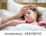 mother measuring temperature of ... | Shutterstock . vector #493198735