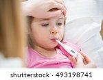 mother measuring temperature of ...   Shutterstock . vector #493198741