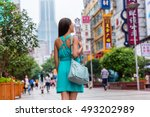 happy girl walking on nanjing... | Shutterstock . vector #493202989