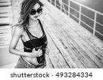 pretty girl in black swimsuit... | Shutterstock . vector #493284334
