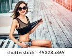 pretty girl in black swimsuit... | Shutterstock . vector #493285369