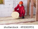 working insulates the attic with mineral wool - stock photo