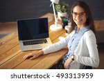 young female working sitting at ... | Shutterstock . vector #493313959