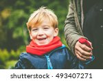 happy child holding mothers hand   Shutterstock . vector #493407271