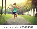 young fitness woman skipping... | Shutterstock . vector #493413889