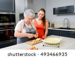 cheerful young woman cooking a... | Shutterstock . vector #493466935